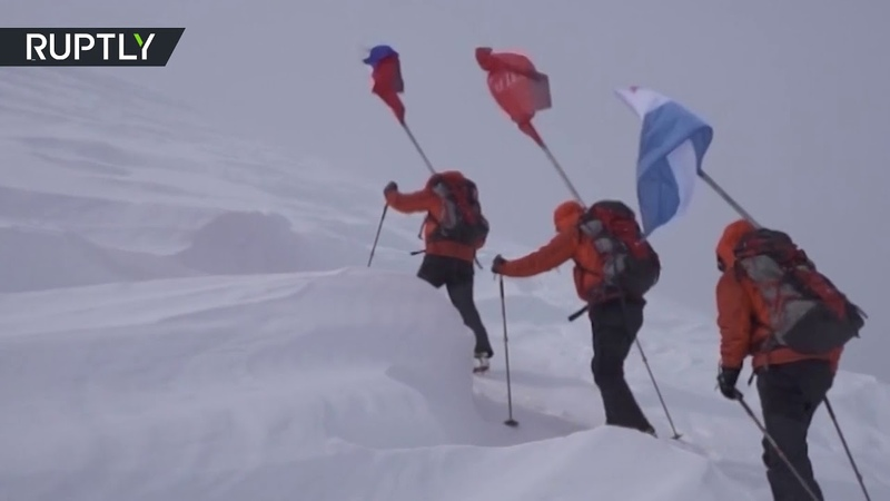 Honoring V-Day heroes   Victory banner Russian flag on top of volcanoes in Kamchatka