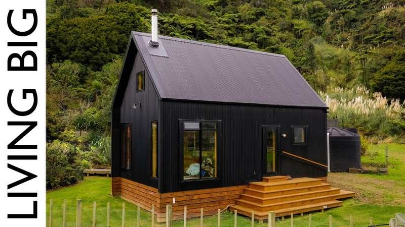 Stunning Black Off Grid Cabin By The River